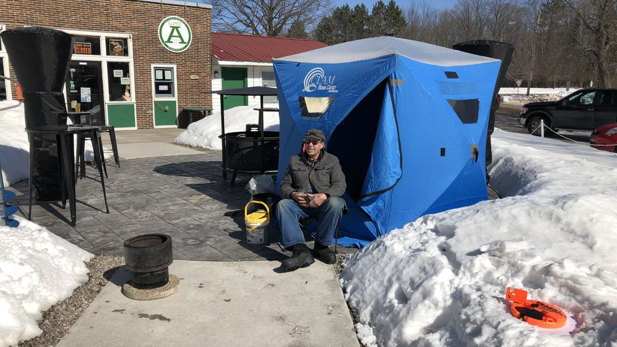 Fred Erwin sets up his ice shack outside Alpha Michigan Brewing Company for 'Tippin UP.' (AMBC...