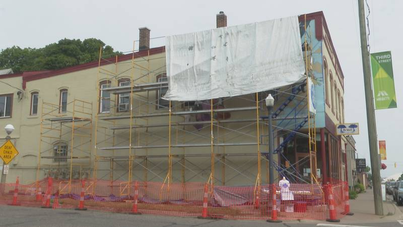 The 28x65 mural is being painted on the side of Be Well in downtown Marquette.