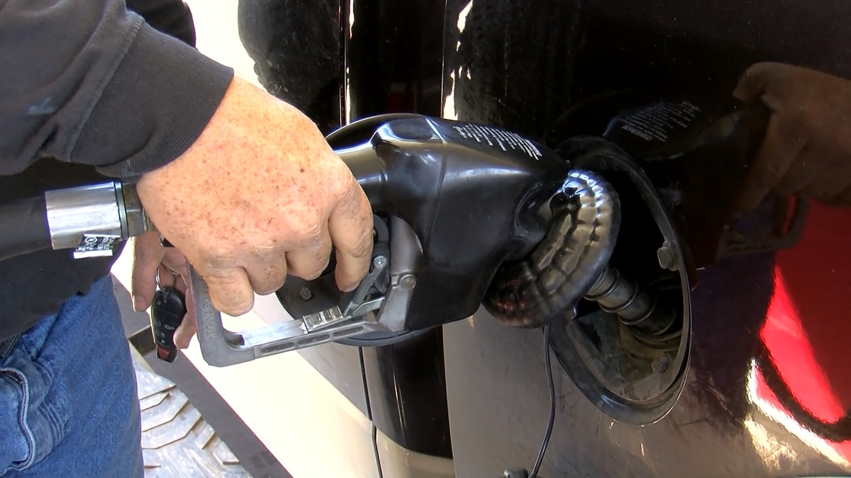 Filling up the car with gasoline.