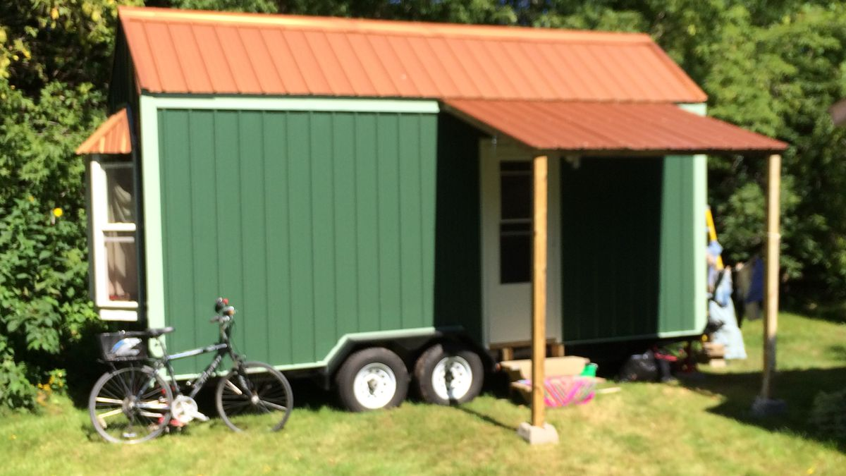 Hitch began building a tiny house in July. The 7.5' by 20' building on wheels is set up in a...