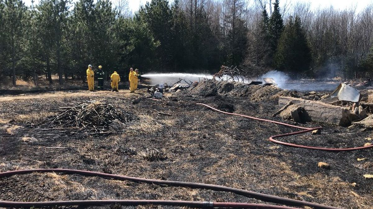 Firefighters spraying water on the fire.