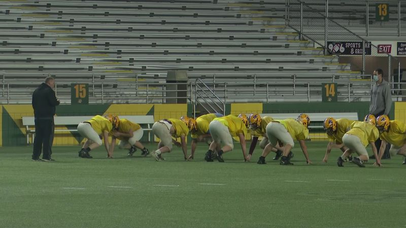 Iron Mountain football practices in the Superior Dome.