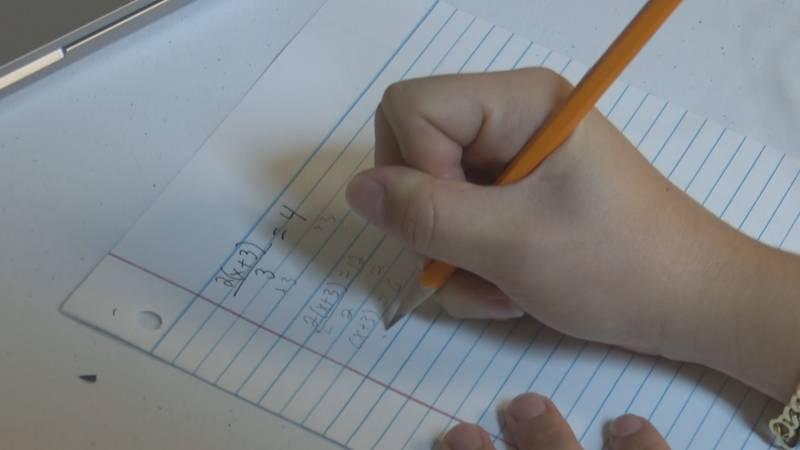 Working through an algebra problem at Math Recalculated tutoring.