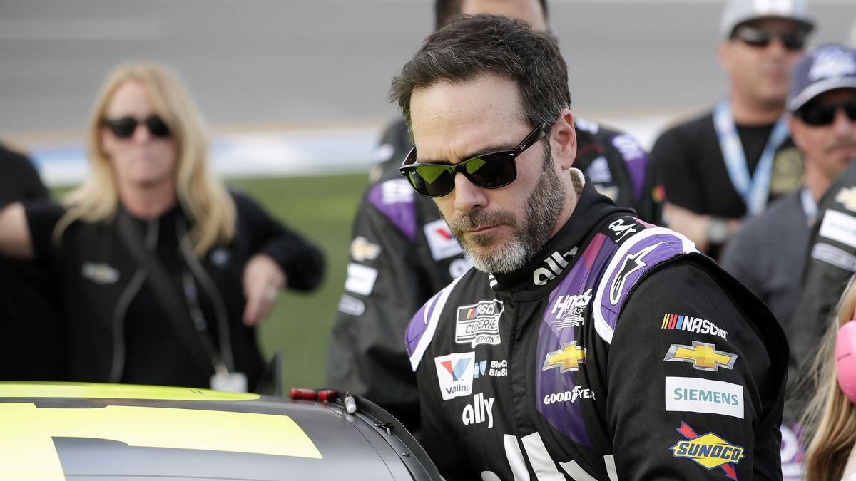 FILE - In this Feb. 16, 2020 file photo Jimmie Johnson climbs intp his car before the NASCAR Daytona 500 auto race at Daytona International Speedway in Daytona Beach, Fla. NASCAR seven-time champion Jimmie Johnson will test an Indy car next week on the road course at Indianapolis Motor Speedway. He's long said he is open to racing in the series but did not want to compete on ovals out of safety concerns. On Friday, July 3, 2020, he indicated recent safety improvements have softened his stance and the Indianapolis 500 is not entirely out of the picture.