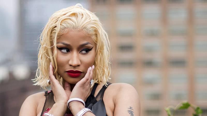 FILE - In this Sept. 11, 2018 file photo, Nicki Minaj attends the Oscar de la Renta show during...