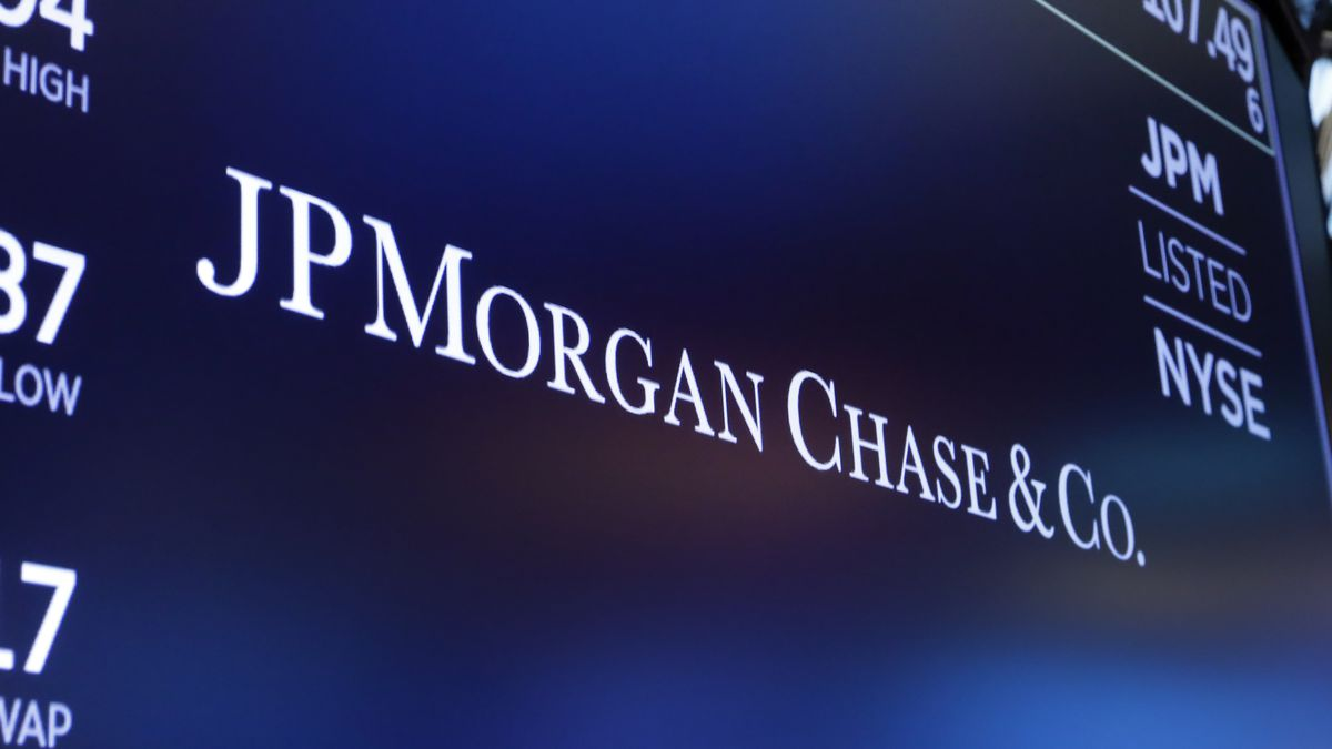 In this Aug. 16, 2019, file photo, the logo for JPMorgan Chase & Co. appears above a trading post on the floor of the New York Stock Exchange in New York.  Shares of some major banks are tumbling before the market open Monday, Sept . 21, 2020, following a report alleging those including JPMorgan, HSBC, Standard Chartered Bank, Deutsche Bank and Bank of New York Mellon continued to profit from illicit dealings with disreputable people and criminal networks despite being previously fined for similar actions.