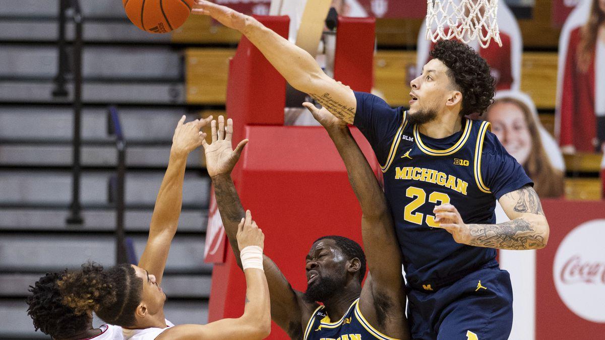 Michigan forward Brandon Johns Jr. (23) blocks a shot by Indiana guard Khristian Lander (4)...