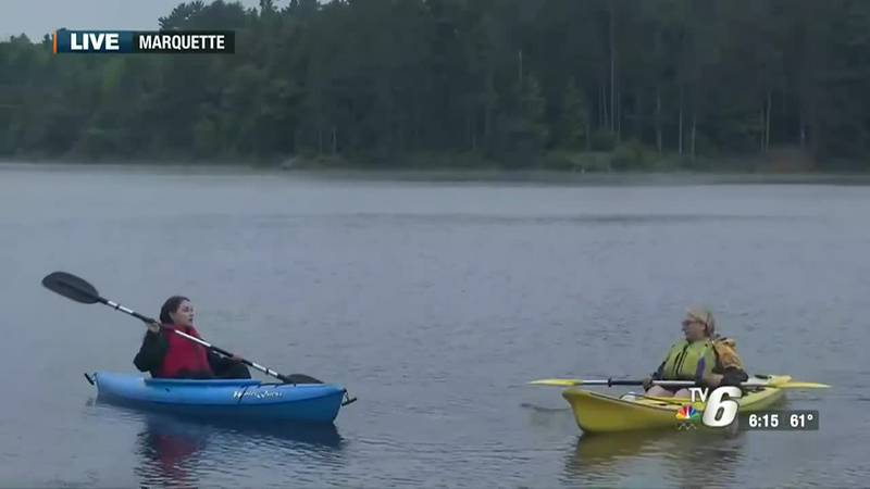 Kayaking with a tour guide from Marquette Recreational Tours.