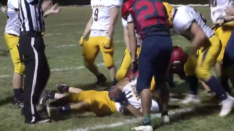 Negaunee's Matt Skewis (#11 on ground) recovers a squib kick in the Miners 42-14 win over...