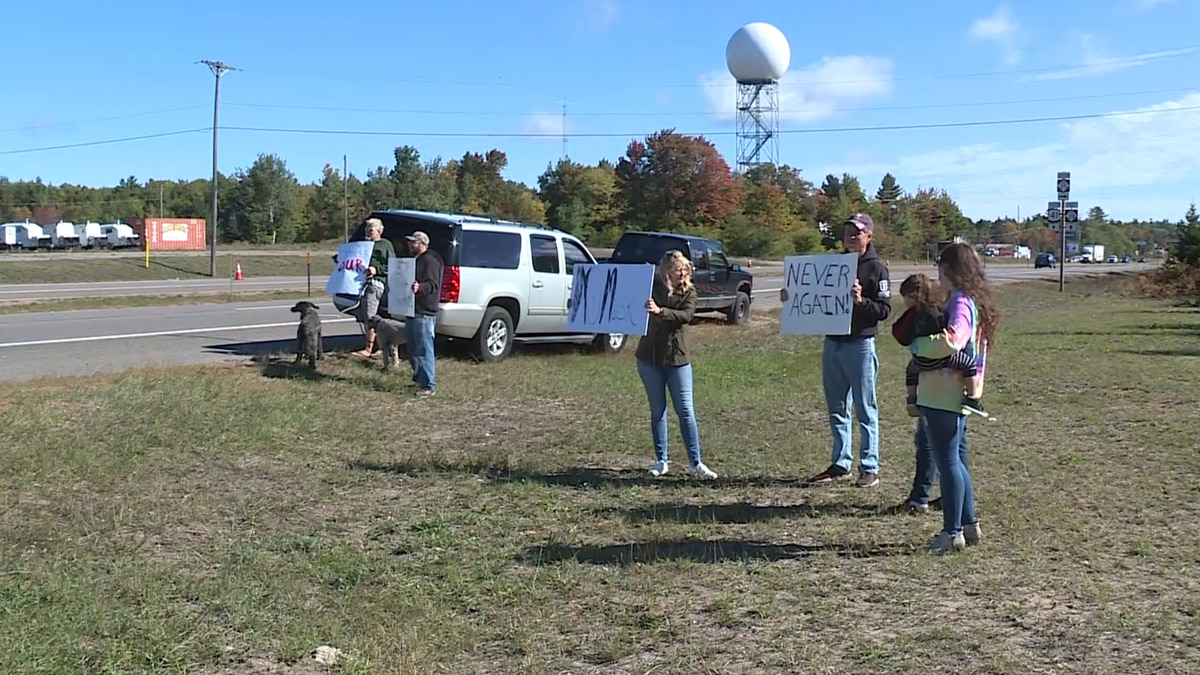 A group of protesters in Negaunee Township