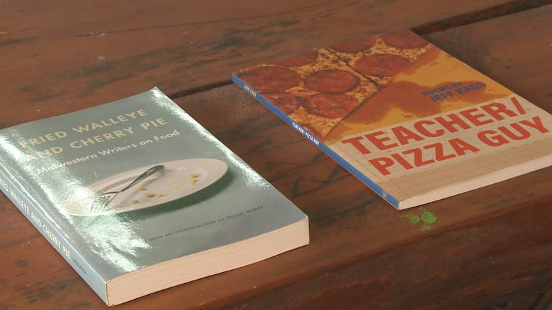 The books chosen for this year are 'Fried Walleye and Cherry Pie' and 'Teacher/Pizza Guy'