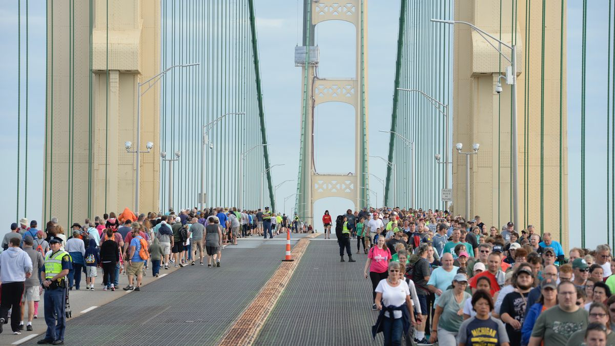 FILE. The 2018 Annual Bridge Walk included a first ever occurrence: walkers going both north...
