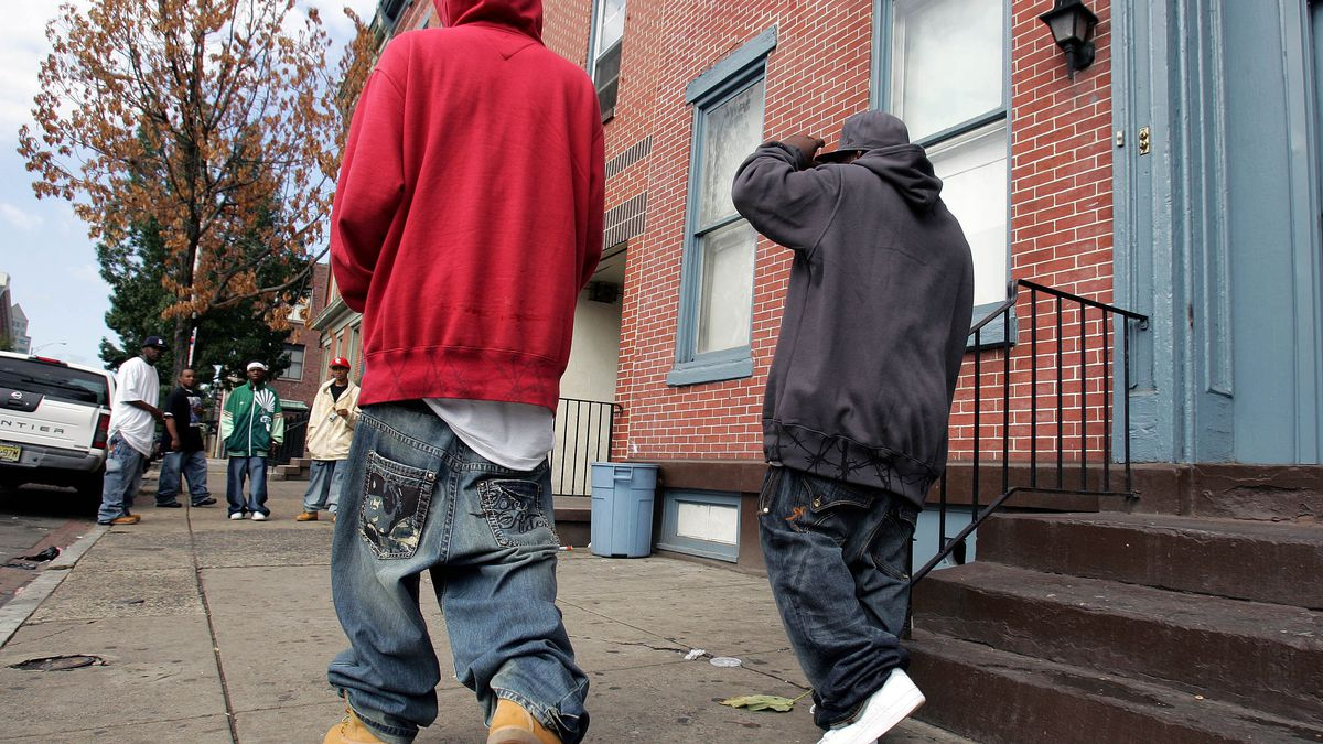 Two young men with low-slung, baggy jeans walk in Trenton, N.J., Saturday, Sept. 15, 2007.