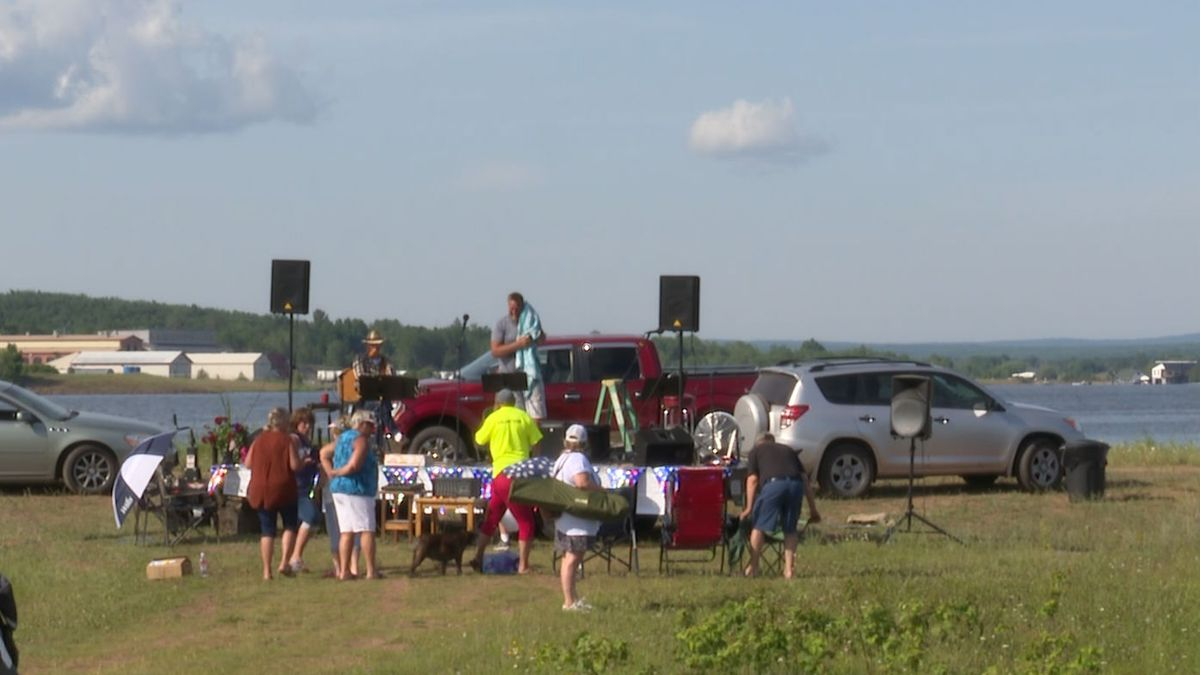 People gather on July 3 in Lake Linden (WLUC Image)