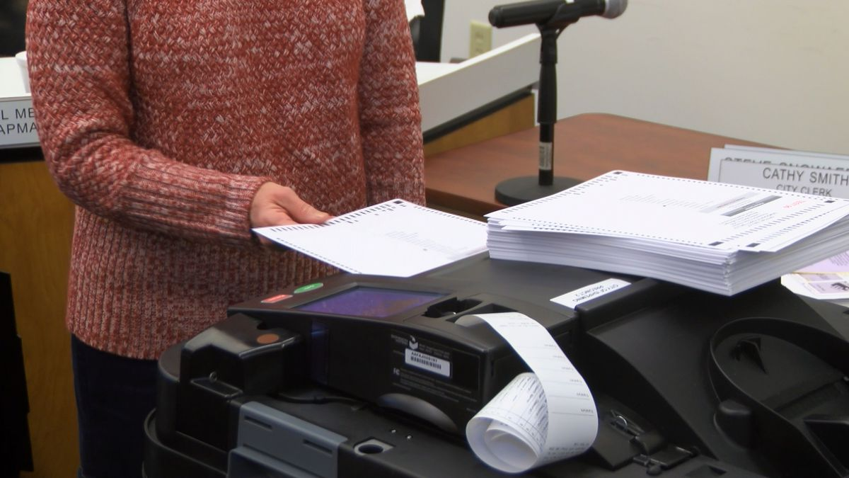 Ishpeming City Clerk Cathy Smith tests voting machines during Public Accuracy Test for upcoming Presidential Primary Election.