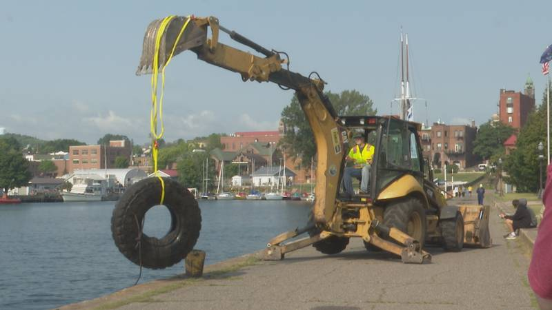 The focus on Saturday was removing tires and other large items from the bottom of the harbor.