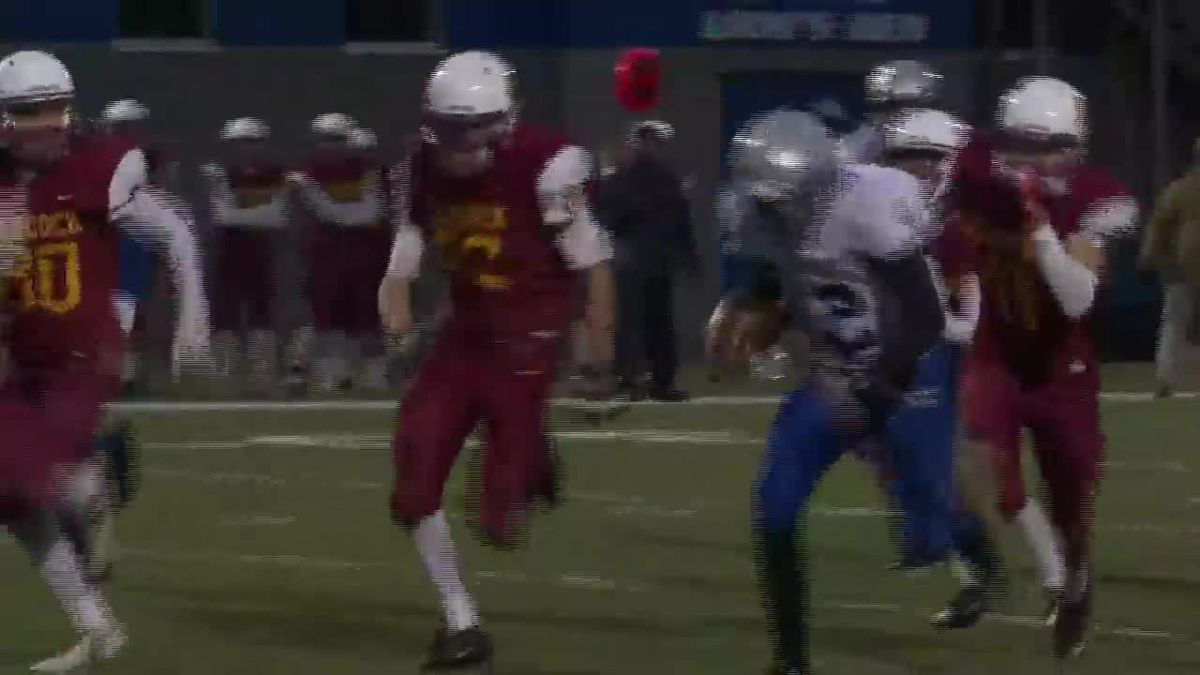 Calumet's Paul Sturos runs away from Hancock defenders for a first quarter touchdown.  Calumet...