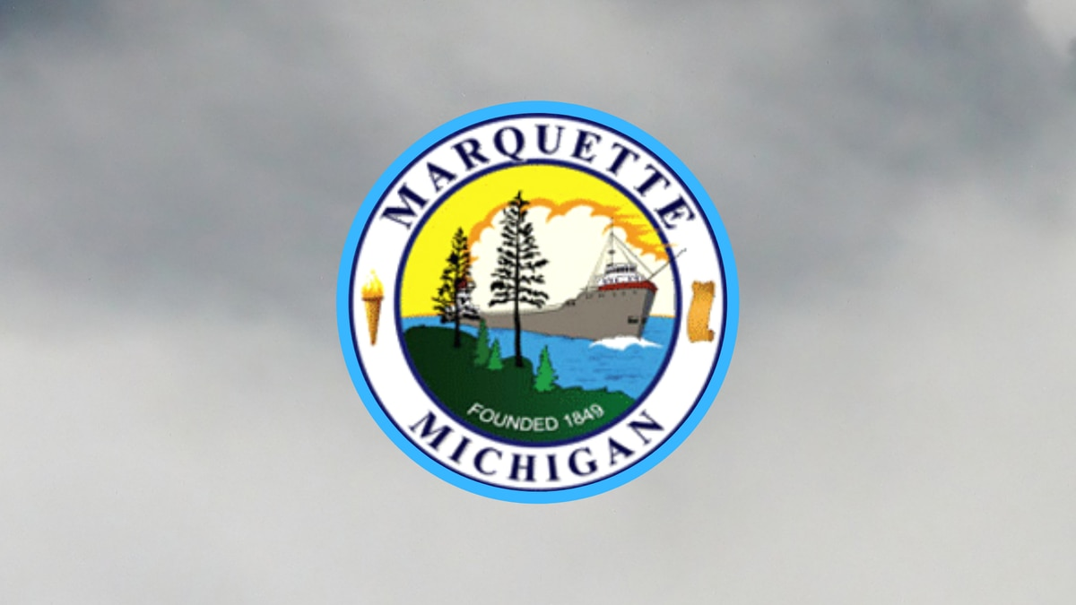 City of Marquette seal with foggy backdrop.