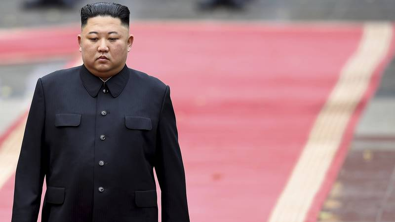 North Korea's leader Kim Jong Un addresses a ceremonial guard of honor during a welcoming...