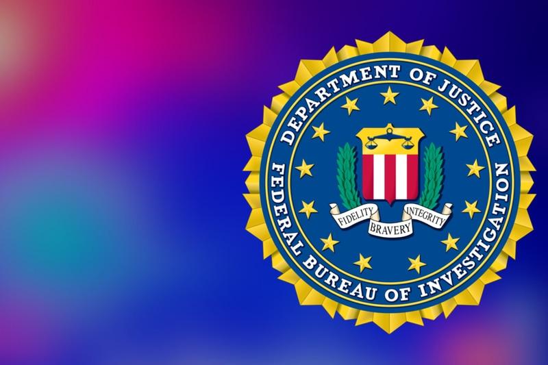 FBI logo and police lights background.