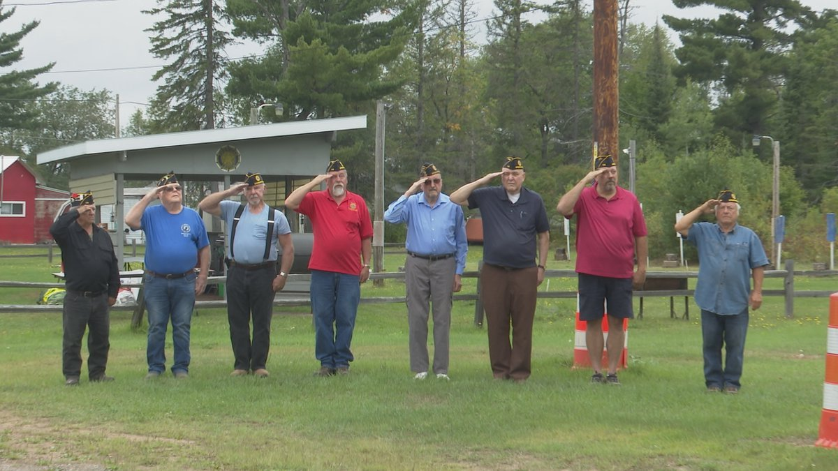 Veterans at American Legion Post 114 saluted the flag as it was lowered.