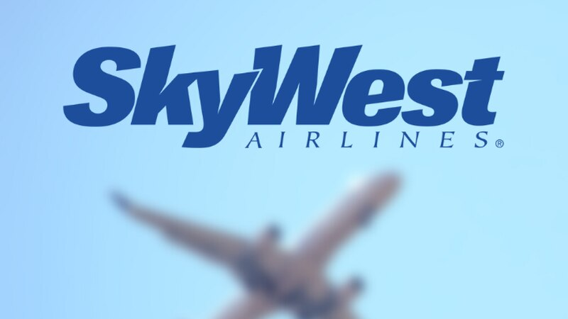 SkyWest Airlines logo over a blurred airplane image.