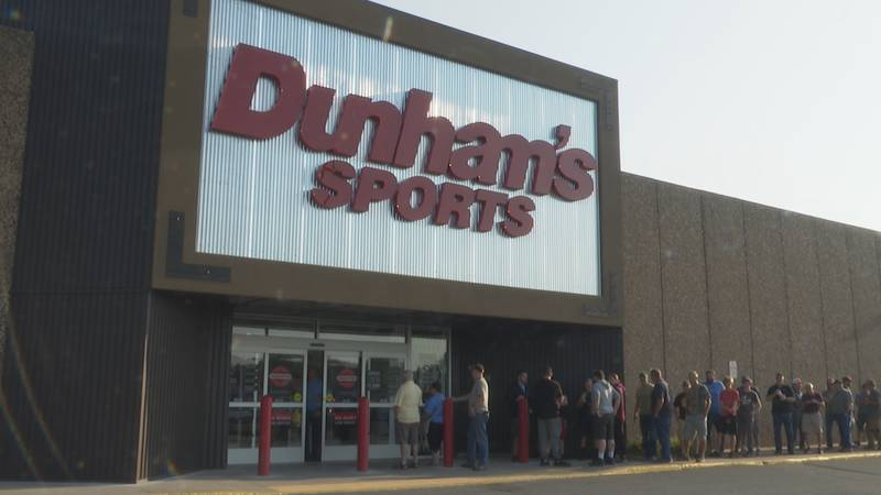 Customers lined up outside of the sporting goods store before its 9AM grand opening.