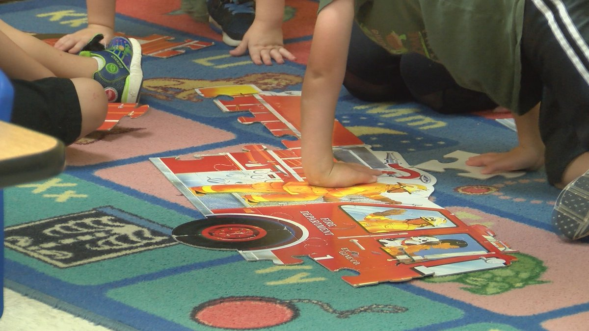 FILE. Children work on a firetruck puzzle.
