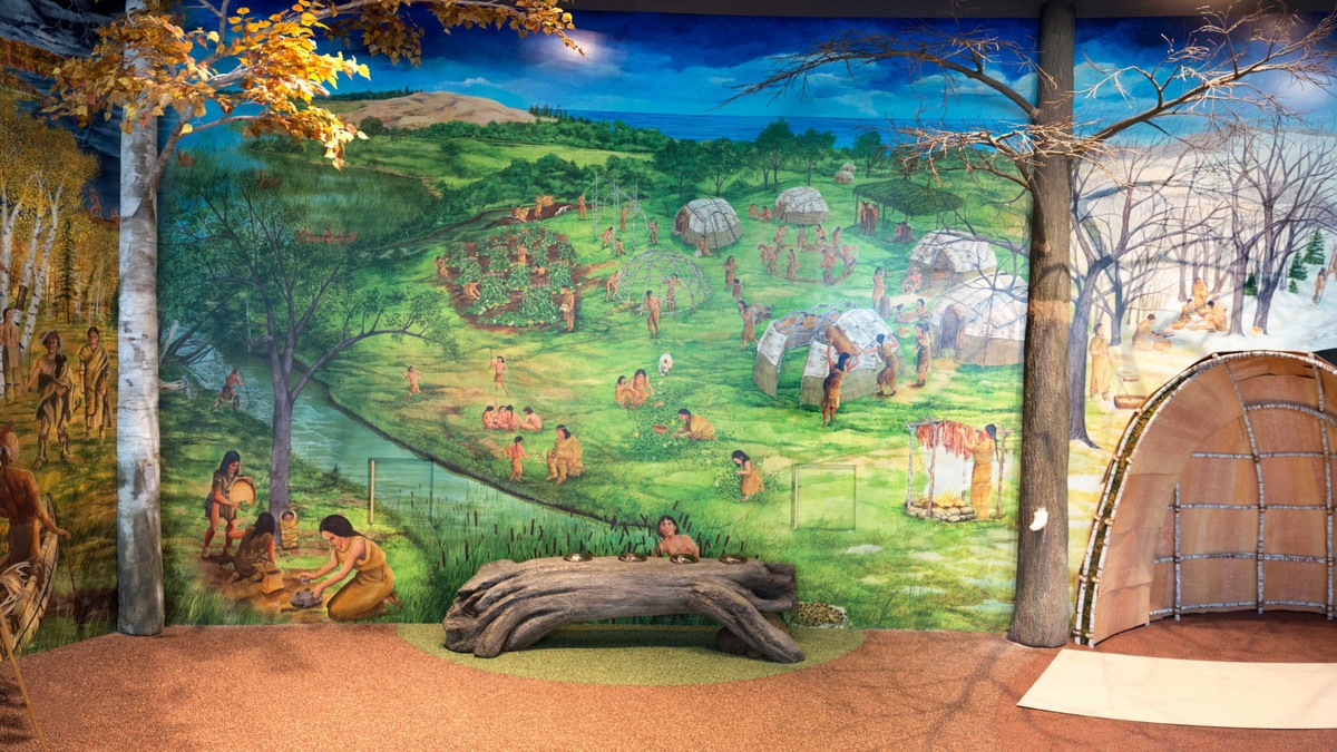 The new exhibit at the Michigan History Museum in Lansing includes a large mural that depicts...