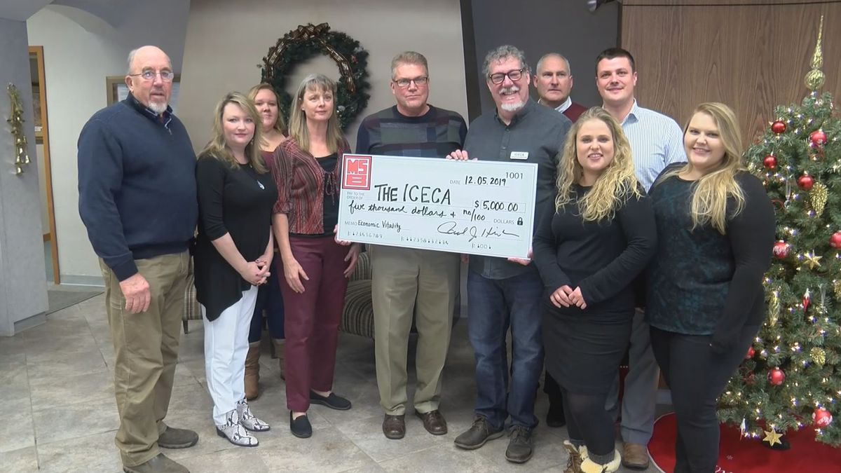 Miners State Bank hands a $5,000 check to the Iron County Economic Chamber Alliance. (WLUC Photo)