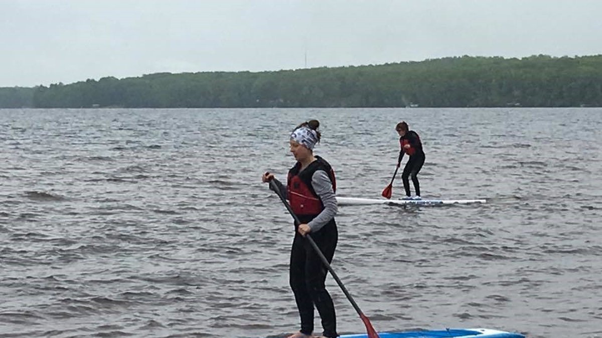 Participants paddleboard in a previous Michigan DNR BOW event.