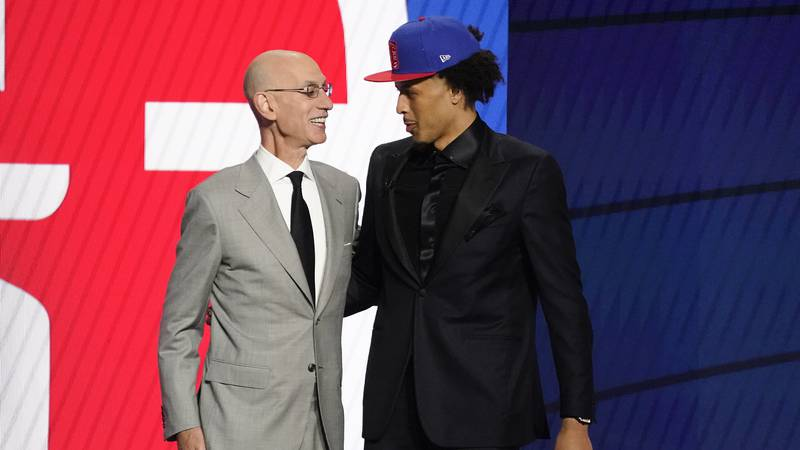 NBA Commissioner Adam Silver greets Cade Cunningham who was picked as the number one overall...