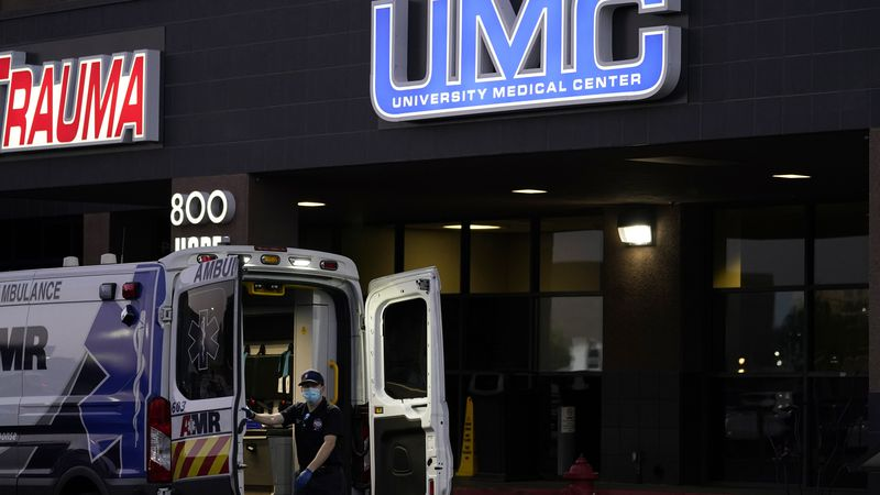 An ambulance is parked at the University Medical Center in Las Vegas on Oct. 12, 2020. Spikes...