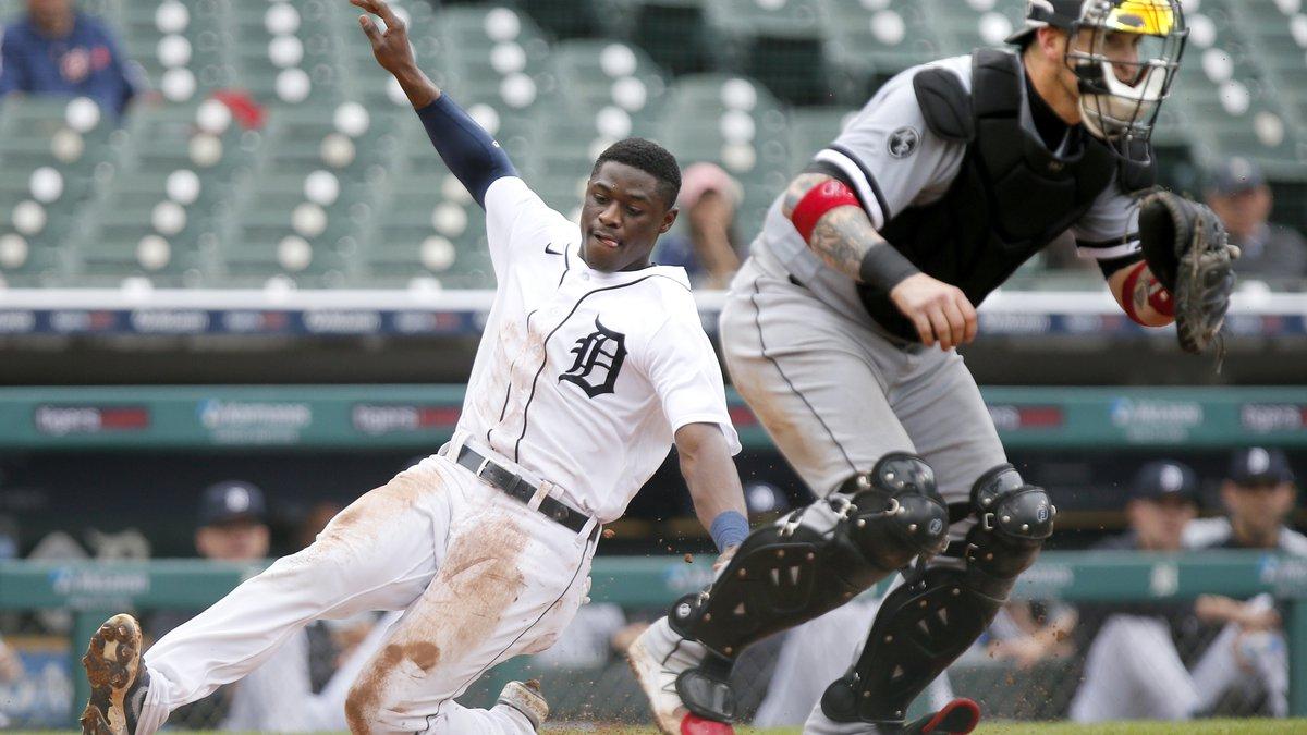 Detroit Tigers' Daz Cameron scores behind Chicago White Sox catcher Yasmani Grandal during the...