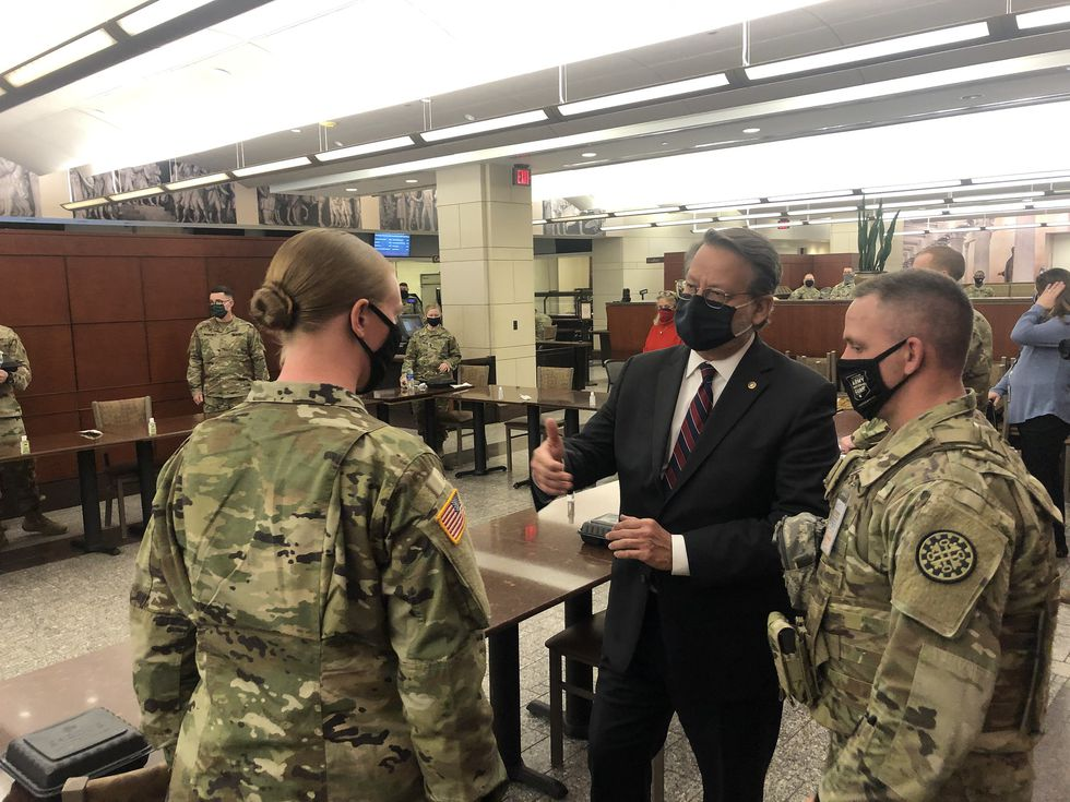 Senator Gary Peters (D-MI) meets with members of the Michigan National Guard on March 5, 2021,...