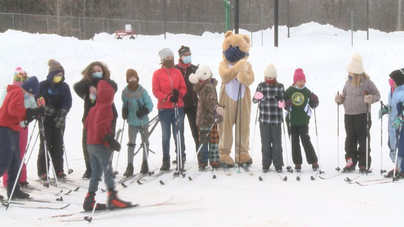 Students line up for a picture with the Honey Bear.