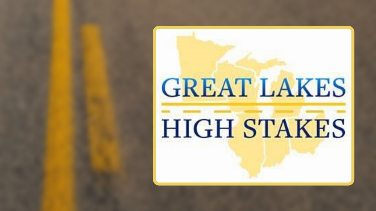 """""""Great Lakes, High Stakes"""" enforcement initiative graphic over a blurred roadway."""