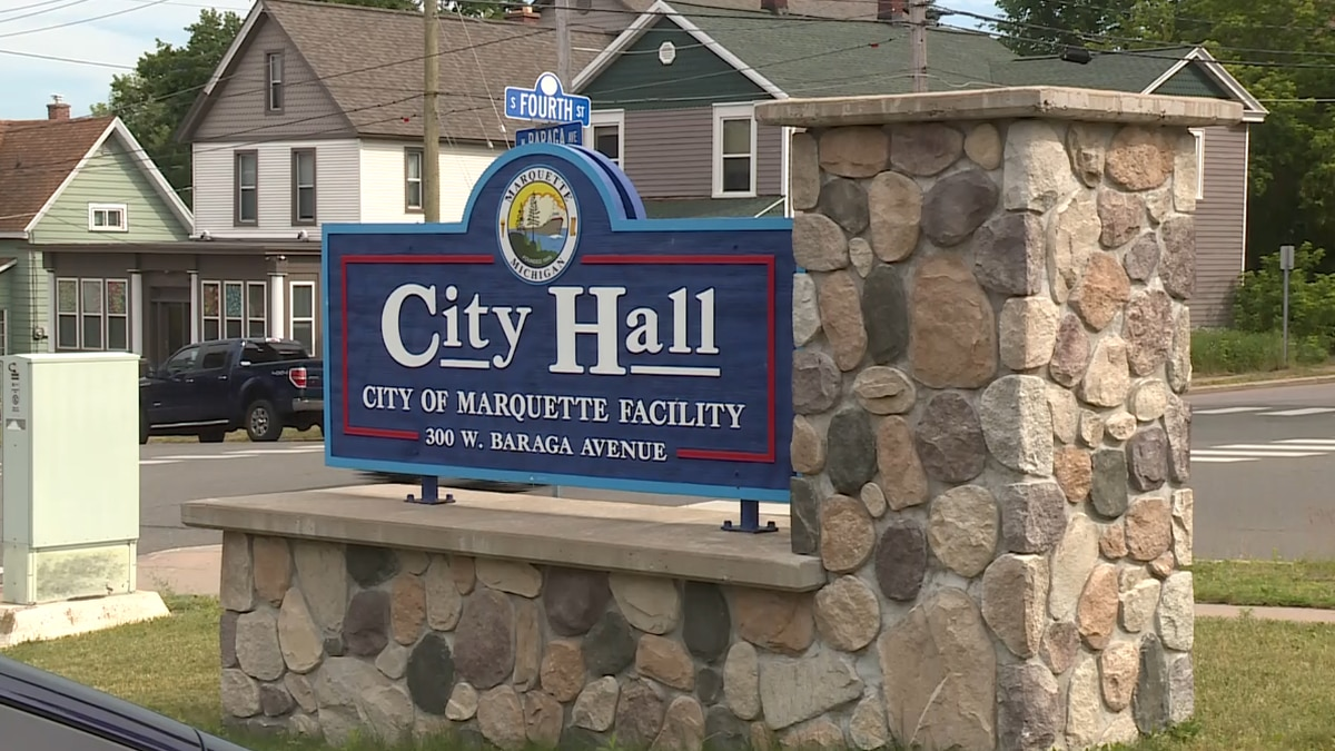 The sign outside Marquette's City Hall building