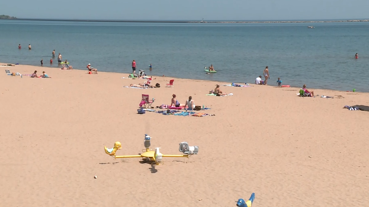 Beachgoers head to South Beach to cool off as temps rise for 4th of July holiday weekend.
