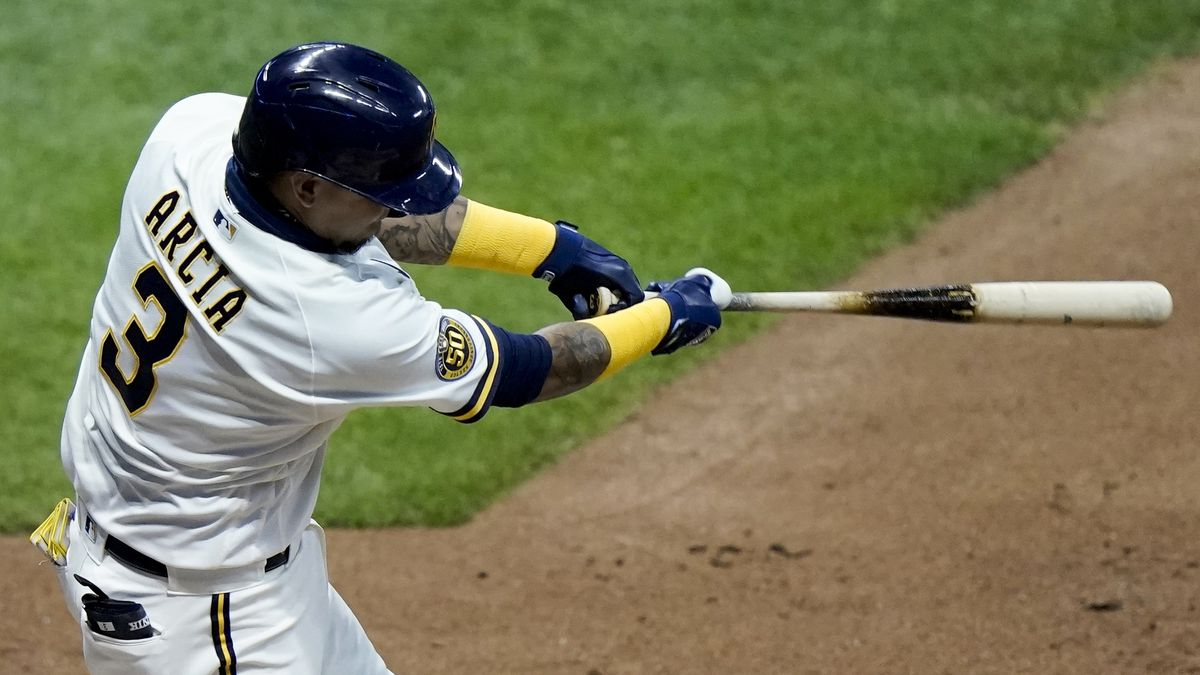 Milwaukee Brewers' Orlando Arcia hits an RBI single during the eighth inning of a baseball game...