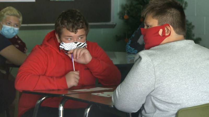 Students learn in the classroom with masks on.