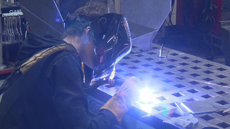 A student welds during a CTE class for the Copper Country ISD. (WLUC Photo)