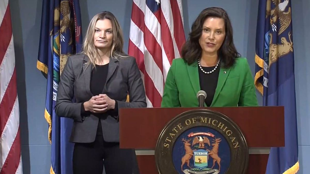 Gov. Gretchen Whitmer, right, and an interpreter during a press conference in August 14, 2020.