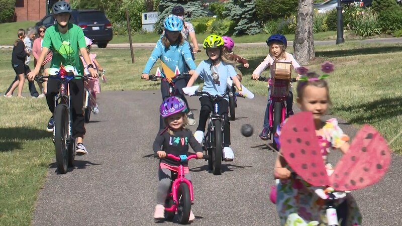 Ladybugs, bears, frogs, lizards and more rode in Wednesday's bike parade.