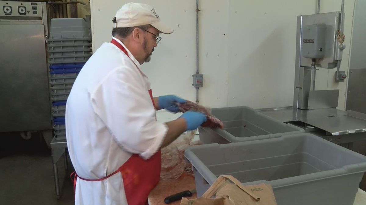 Pat Sommers packages meat to donate in Iron County. (WLUC Photo)