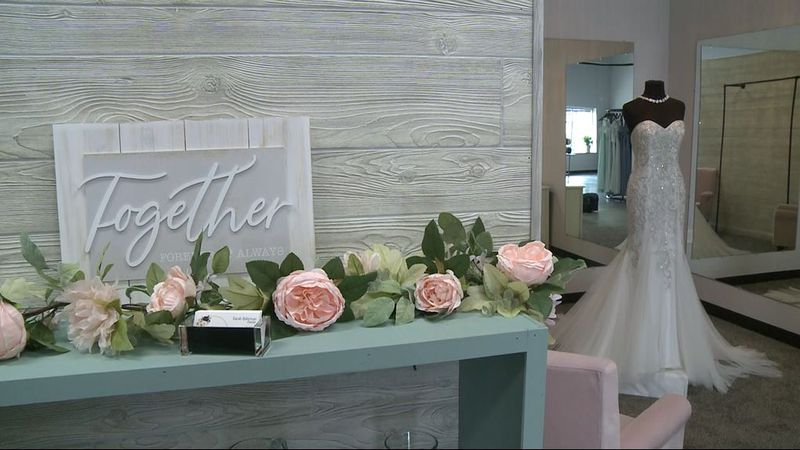 Owner Sarah Bahrman's bridal shop features tuxedo rentals and off-the-rack wedding dresses for...