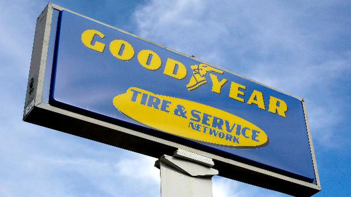 FILE- In this Nov. 30, 2017, file photo a Goodyear sign stands outside a Goodyear Auto Service Center, in Stoneham, Mass. The Goodyear Tire & Rubber Company reports earnings Wednesday, April 25, 2018. (AP Photo/Steven Senne, File)