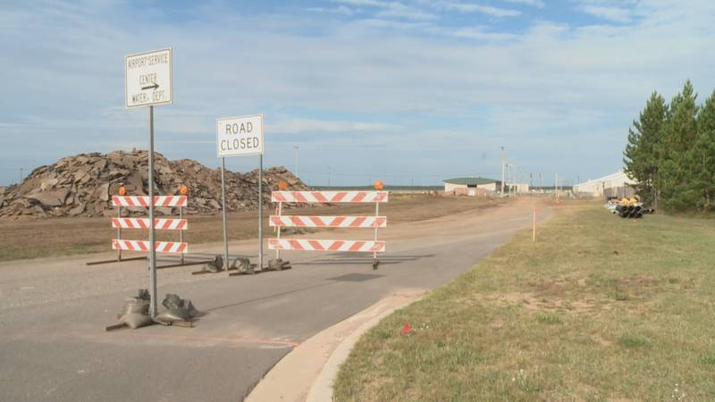 Signs are posted to guide airport traffic through the detour.