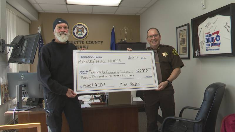 Mike Neiger donated a check for nearly $21 thousand.