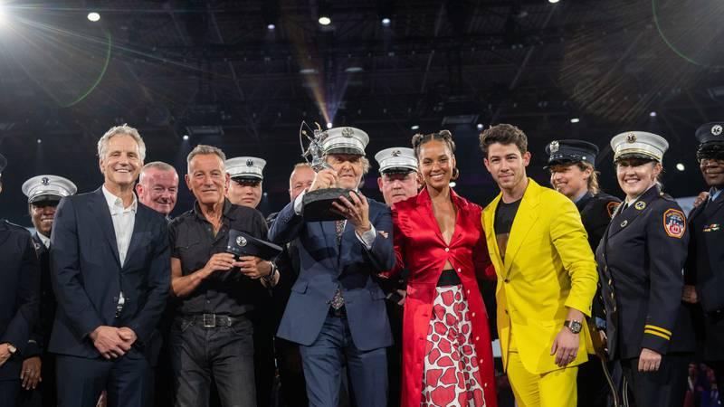 John Sykes, Bruce Springsteen, Alicia Keys, Nick Jonas and a group of a group of New York City...